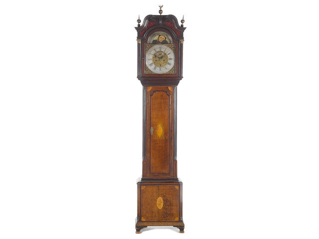 A good late 18th century oak and mahogany longcase clock with world time dial and phases of the moon John Taylor, Manchester