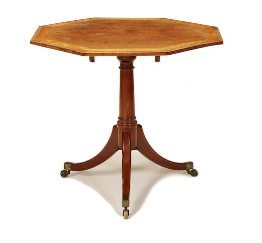 An early 19th Century mahogany and satinwood crossbanded tripod table