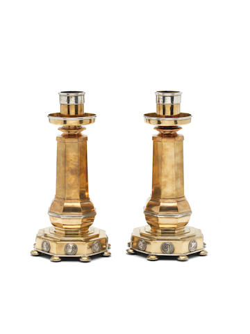 Henry Wilson A Rare and Impressive Pair of Brass and Silver-plated Candlesticks, designed 1913