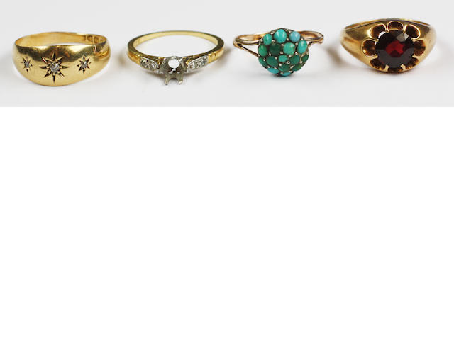 An 18ct gold gypsey set diamond ring,an 18 ct gold garnet set ring and two others