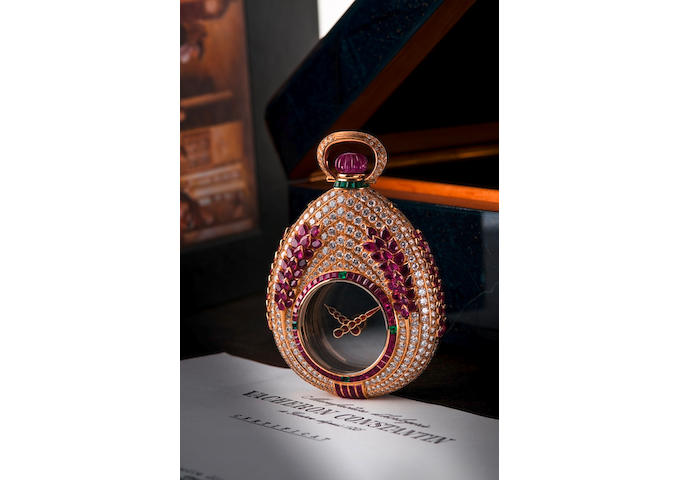 "Vacheron Constantin. An unique 18ct gold diamond ruby and emerald manual wind hunter pocket watch  ""Mysterieuse"", Circa 1988"