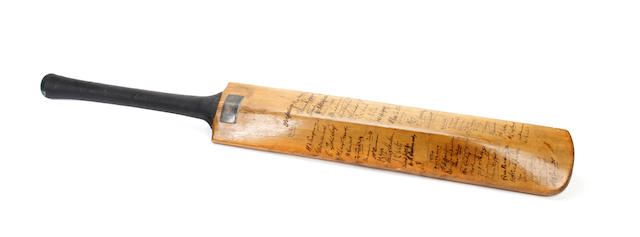 A cricket bat hand signed by the Australian and English cricket teams of 1929/1934