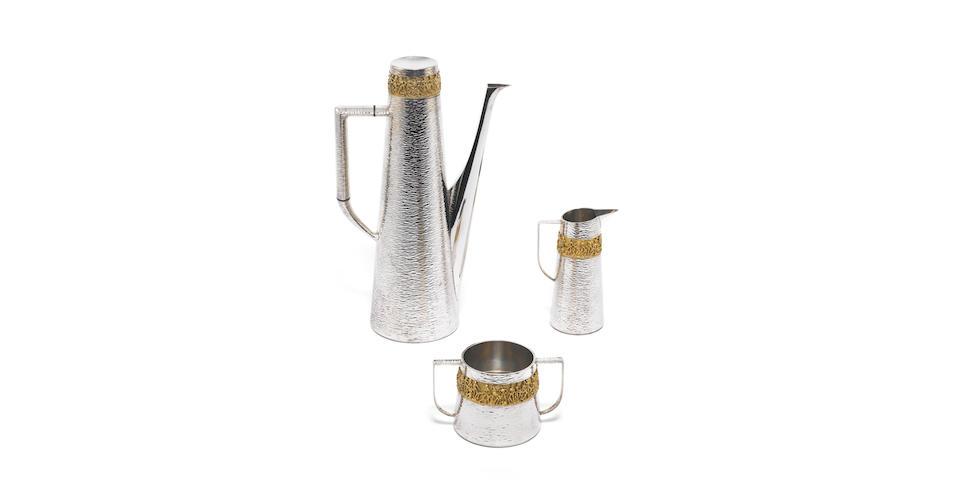 STUART DEVLIN: A silver and silver-gilt three-piece coffee service, London 1974,  (3)
