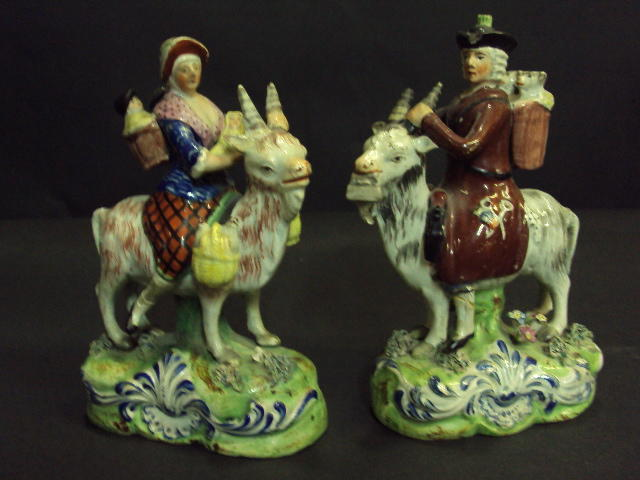 A pair of Staffordshire pearlware figures of the Welch Tailor and his wife