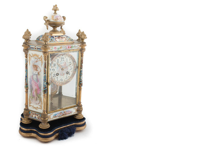 A 19th century French gilt brass champleve enamel and porcelain mounted mantel clock