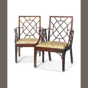 A pair of George III 'Chinese Trellis' armchairs