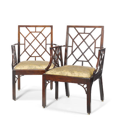 A pair of George III mahogany 'Cockpen' open armchairs