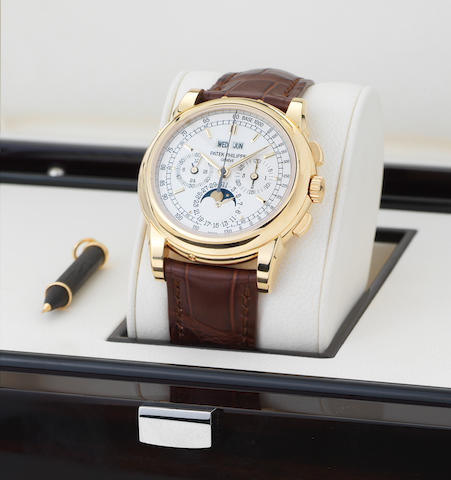 Patek Philippe. A fine and rare 18ct gold perpetual calendar chronograph wristwatch with moon phases, original certificate and spare back Ref: 5970, Case No.4462754, Movement No.3049582 Sold 31st October 2008