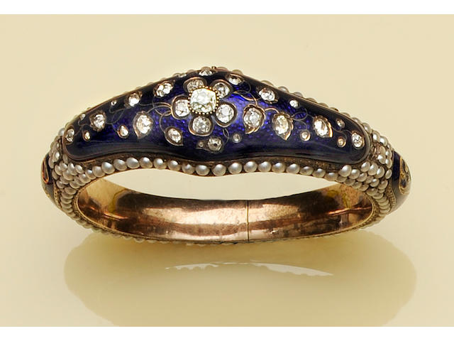 A Victorian enamel, diamond and pearl bangle