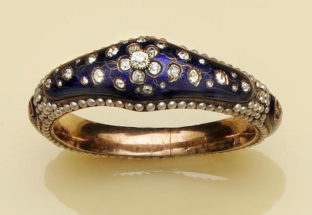 A Victorian enamel, diamond and pearl bangle