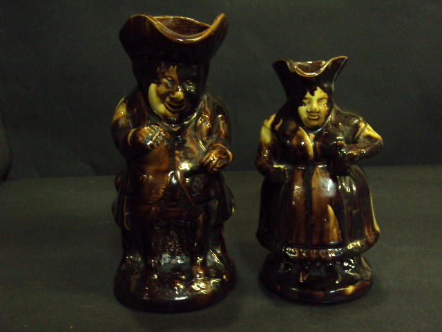 Two 19th century treacle glazed toby jugs