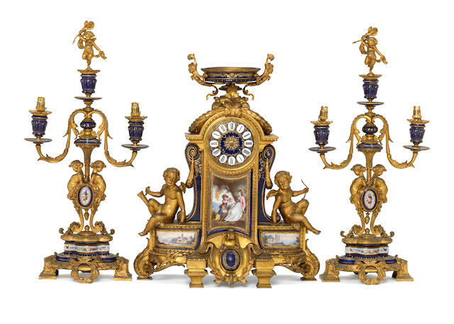 A large mid 19th century porcelain mounted ormolu mantel clock and associated side pieces Japy Freres