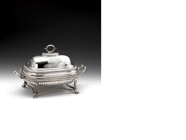 Paul Storr, London, 1809, a silver entree dish with cover, engraved with an armorial, with a Sheffield plate warming basin and stand