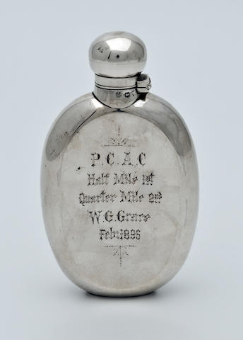 A silver hip flask, presented to W.G.Grace