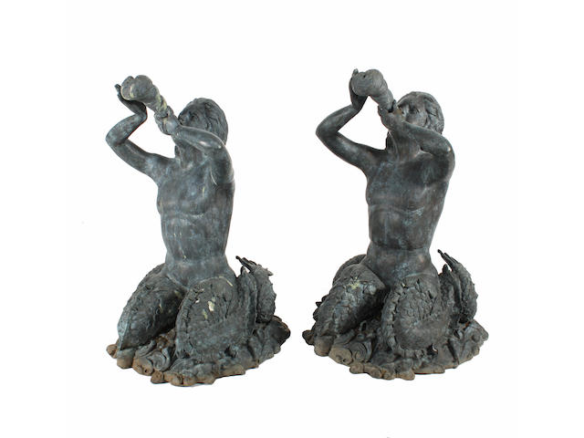 A pair of verdigried bronze figural fountains each in the form of a seated triton, 20th century