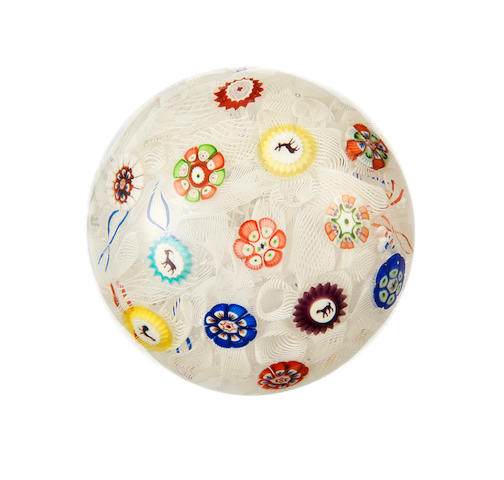 A Baccarat spaced millefiori paperweight