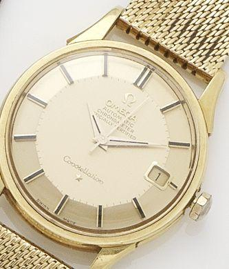 Omega. An 18ct gold automatic calendar bracelet watch1960's