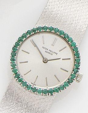 Patek Philippe. A Lady's white gold and emerald set bracelet watch Ref.3355, Case No.2671190, Movement No.995802