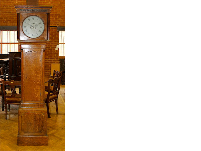 An early 19th century oak longcase clock