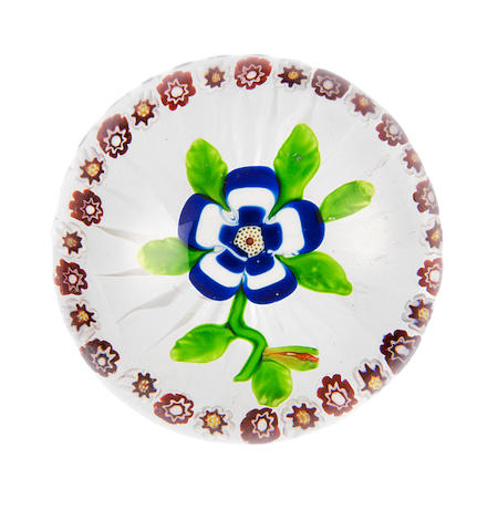A Baccarat garlanded blue and white primrose paperweight