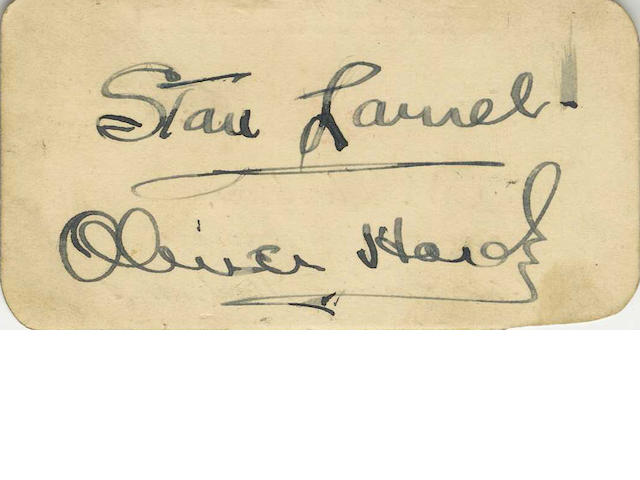 Laurel and Hardy: An autographed card,