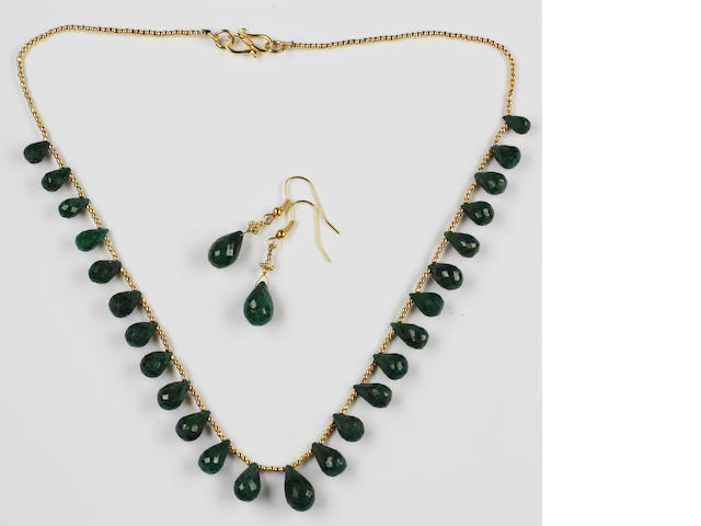 An emerald fringe necklace and earrings