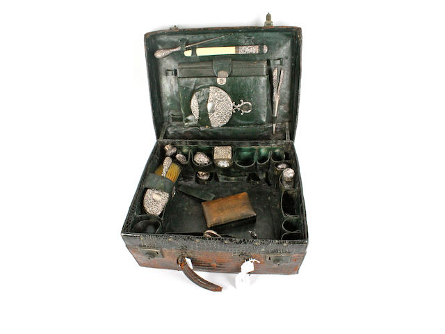 A Victorian brown crocodile skin  vanity case with silver mounted interior fittings London, 1898,