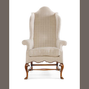 A Queen Anne walnut wing armchair