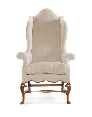 A Queen Anne walnut wing armchair