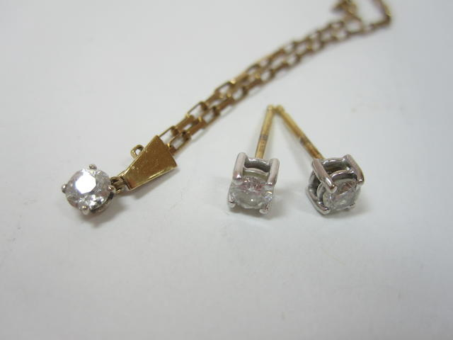 A pair of diamond earstuds and a diamond pendant