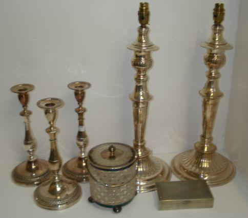 A set of three George III style electroplate candlesticks, with baluster stems and spreading circular bases, pair of taller similar adapted as table lamps, late Victorian mounted cylindrical cut glass biscuit barrel, similar period cruet stand, four piece tea and coffee service and other items.