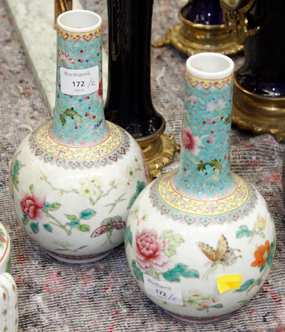 A pair of early 20th Century Chinese famille rose bottle vases,