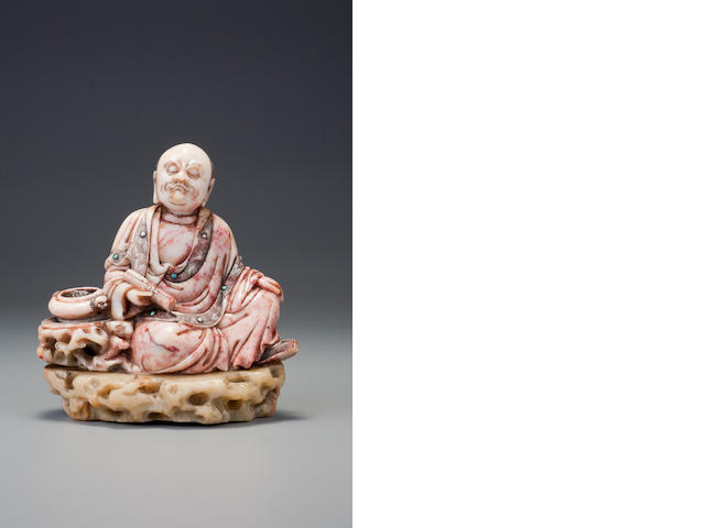 A carved 'gaoshan' figure of a seated luohan, by Zixiu Early Qing dynasty