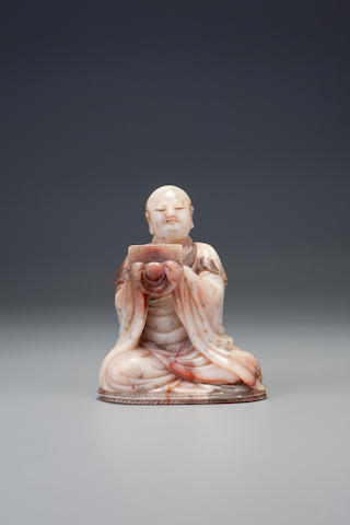 A carved 'gaoshan' figure of a seated luohan, by Yang Yuxuan Early Qing dynasty