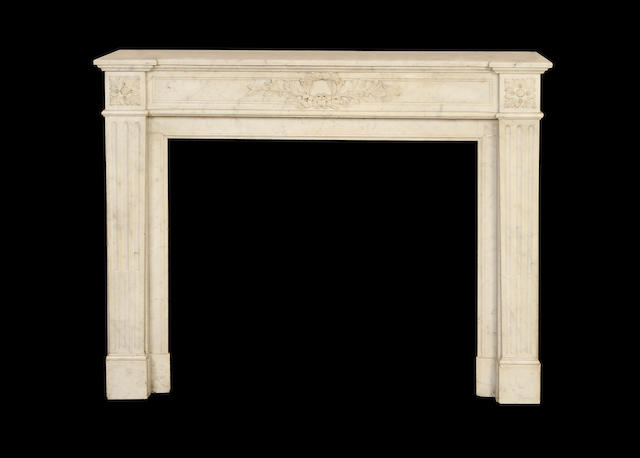 A French late 19th century Carrera marble chimneypiece in the Louis XVI style