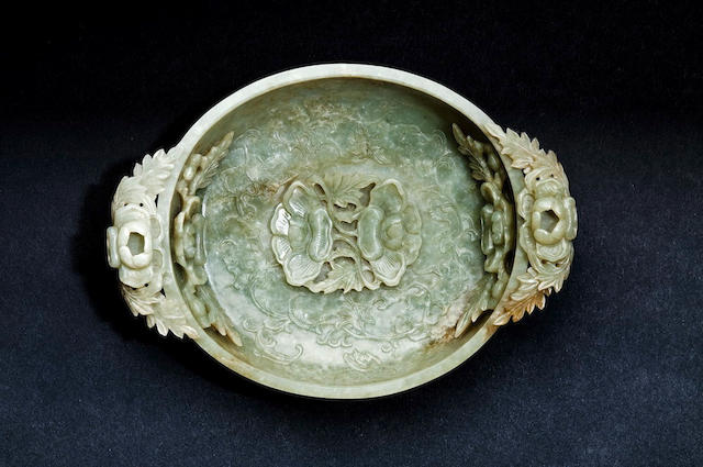 A finely carved pale green jade 'lotus' bowl Early Qing dynasty