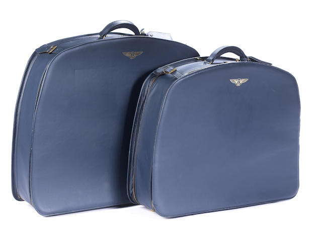 A matching pair of Bentley suitcases,