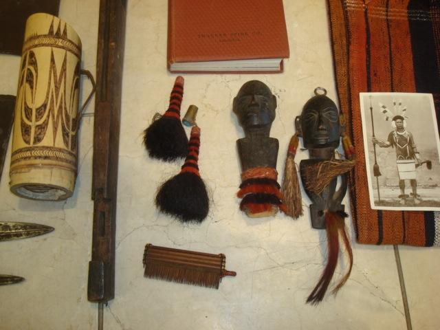 A collection of Nagas tribal artifacts,to include two spears, a bow and arrows, two hand axes, two textile items, a book entitled Naked Nagas and a small quantity of photographs