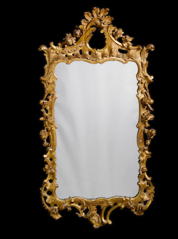 A George III carved giltwood mirror in the rococo taste