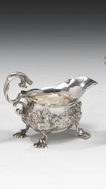 A George II rococo cast silver cream-boat/jug