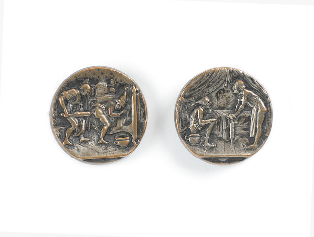 A rare pair of pictorial stamped surgeon's cloak buttons, most probably German, early 18th century,