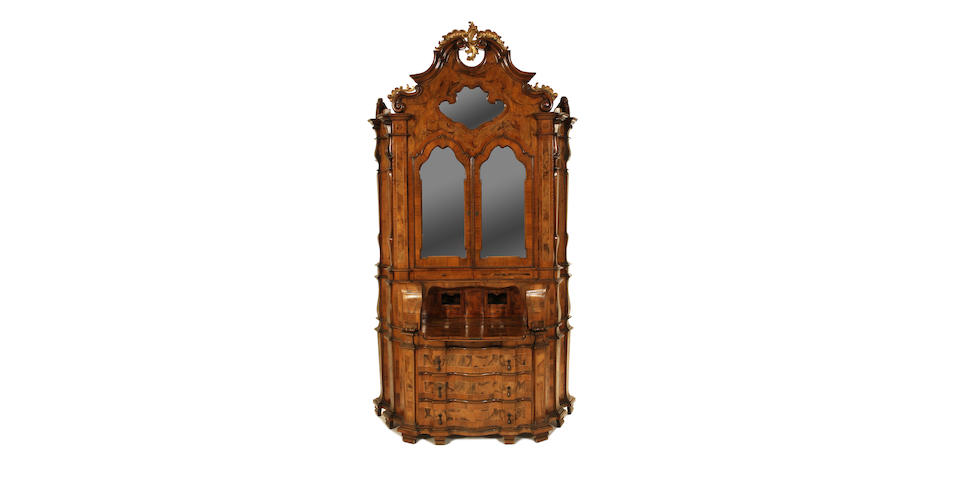 A Venetian walnut and parcel gilt bureau cabinet in the second quarter 18th century style