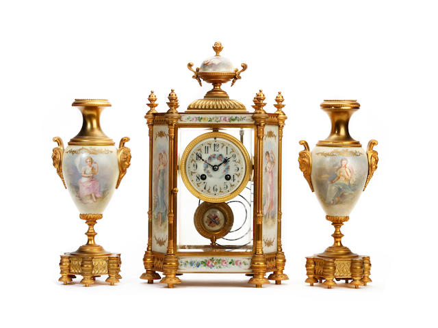 A late 19th Century French porcelain and brass 3pc clock garniture