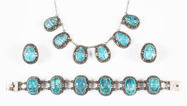 An Egyptian revival faience scarab necklace, bracelet, and pair of earrings With Egyptian part assay marks,