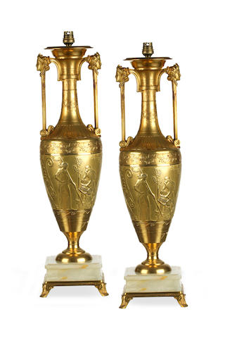 A pair of Napoleon III gilt bronze vases cast by Ferdiand Barbedienne after a model by Henry Cahieux