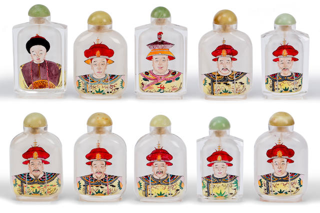 A boxed set of ten Chinese inside painted snuff bottles