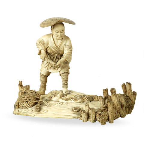 A Japanese carved ivory figure of a fisherman Meiji period