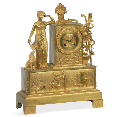 An Empire gilt metal mantle clock