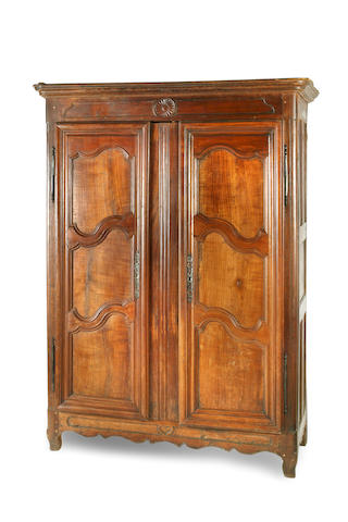 A Louis XV period oak, walnut and cherry armoire French, 18th century