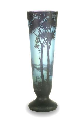 A Daum Nancy three colour cameo blue glass landscape vase